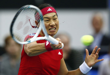 Japan's Date-Krumm hits a return against Russia's Makarova during their Fed Cup first round tennis match in Moscow
