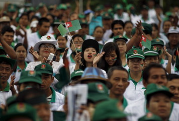 Supporters react during a USDP campaign rally in Yangon