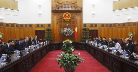 Britain's Foreign Secretary Philip Hammond and Vietnam's Prime Minister Nguyen Xuan Phuc talk at the Government Office in Hanoi