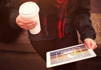 Tablet User Walking with Coffee