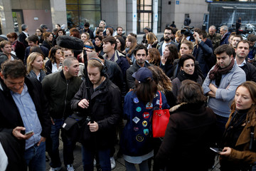 Employees of television channels Groupe Canal+ gather in front of iTELE television channel headquarters in Boulogne