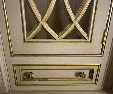 24-Karat gold lining cabinets inside a for sale, $37 million dollar luxury home are seen in Newport Beach