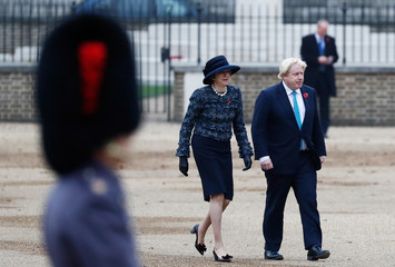 Britain's Prime Minister Theresa May and Foreign Secretary Boris Johnson arrive to take part in a ceremonial welcome at Horse Guards Parade for Colombia's President Juan Manuel Santos and his wife Maria Clemencia de Santos, in central London