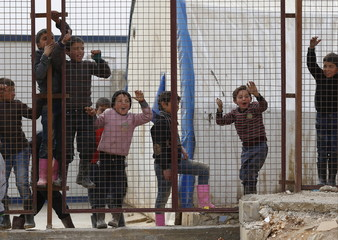 Internally displaced Syrian children play at a refugee camp near the Bab al-Salam crossing, across from Turkey's Kilis province, on the outskirts of the northern border town of Azaz, Syria