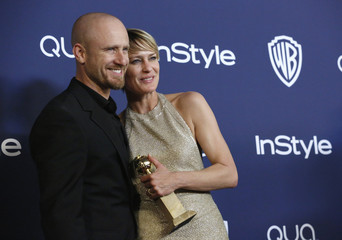 """Wright holds her award for Best Actress in a TV Series, Drama for her role in """"House of Cards"""" next to Foster at the 15th annual Warner Bros. and InStyle after party in Beverly Hills"""