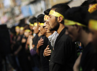 Shi'ite Muslims beat their chests during a Muharram procession to mark Ashoura in Delhi