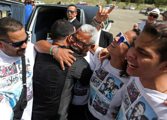 Jesus Serrano Oquendo, father of Xavier Emmanuel Serrano Rosado, one of the victims of the shooting at the Pulse night club in Orlando, embraces his other son, Carlos Manuel Serrano, during the funeral in Ponce