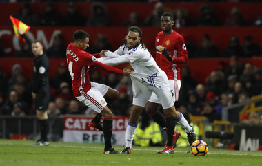 Manchester United's Jesse Lingard pulls the shirt of Sunderland's Jason Denayer as they are in action