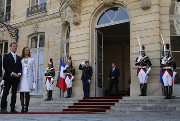 French Prime Minister Manuel Valls and his wife Anne Gravoin wait for a guest at the Hotel Matignon in Paris