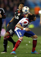 Atletico Madrid's Mandzukic and Bayer Leverkusen's Wendell fight for the ball during their Champions League round of 16 second leg soccer match in Madrid