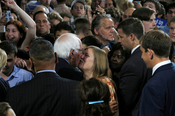 U.S. Democratic presidential candidate Senator Bernie Sanders kisses his wife Jane while greeting audience members at a campaign event with Hillary Clinton in Portsmouth