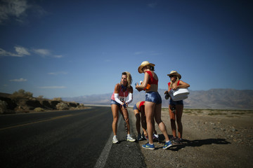 Farar-Griefer of Hidden Hills, California, is given water by her team as she competes in the Badwater Ultramarathon in Death Valley National Park