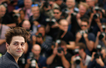 "Director Xavier Dolan poses during a photocall for the film ""Juste la fin du monde"" (It's Only the End of the World) in competition at the 69th Cannes Film Festival in Cannes"