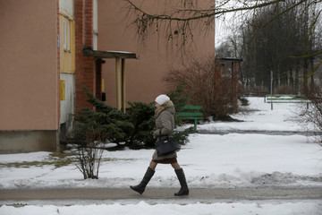 A woman walks about 5 km (3,1 miles) from the border with Russia in Karsava