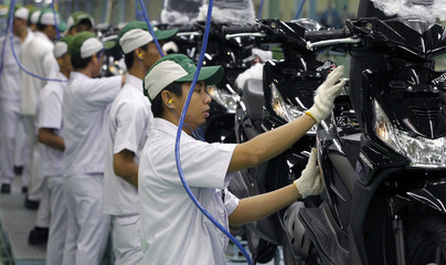 Workers assemble motorcycles at the PT Astra Honda Motor motorcycle factory in Cikarang on the outskirts of Jakarta