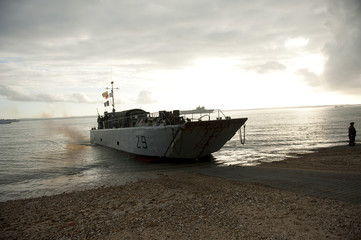 A French naval landing craft reaches the shore during a full invasion exercise on Browndon beach in Gosport, southern England