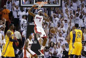 Miami Heat's James slam dunks against the Indiana Pacers during Game 7 of their NBA Eastern Conference final basketball playoff in Miami