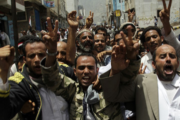 Anti-government protesters shout slogans during a demonstration to demand the ouster of Yemen's President Ali Abdullah Saleh in the southern city of Taiz
