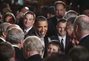 U.S. President Barack Obama greets members of the audience in the East Room of the White House in Washington