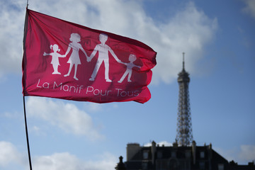 "A trademark pink flag waves in the sky near the Eiffel Tower during a protest march called, ""La Manif pour Tous"" (Demonstration for All) against France's legalisation of same-sex marriage, in Paris"