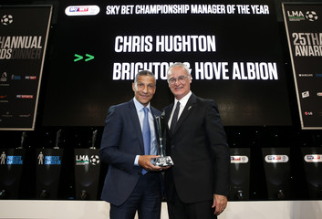 Claudio Ranieri  presents Brighton manager Chris Hughton with the Championship Manager Of The Year 2017 award