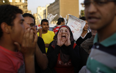 A woman takes part in a protest against the results of the first round of presidential elections at Tahrir Square in Cairo