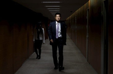 Japan Post Bank Co chief investment officer Sago arrives at an interview with Reuters at the bank's head office in Tokyo