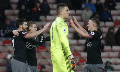 Southampton's Shane Long celebrates scoring their fourth goal with team mates as Sunderland's Vito Mannone looks dejected