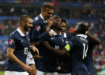 France's Pogba celebrates with team mates after scoring against Portugal during their friendly soccer match at the Stade de France in Saint-Denis