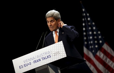 U.S. Secretary of State John Kerry reacts as he delivers a statement on the Iran talks deal at the Vienna International Center in Vienna, Austria