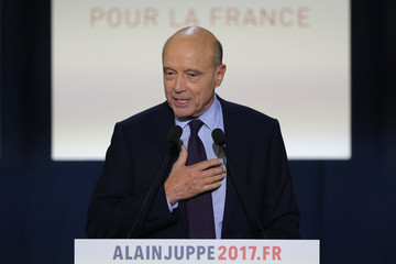 French politician Alain Juppe, current mayor of Bordeaux, and member of the conservative Les Republicains political party, attends a rally as he campaigns in the second round for the French center-right presidential primary in Toulouse
