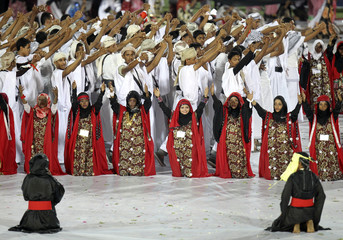 Performers take part in the opening ceremony of the Gulf Cup soccer tournament in 22 May Stadium in Aden