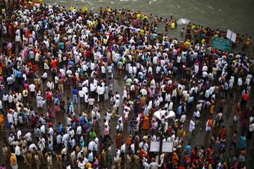 Devotees attend the second Shahi Snan on the banks of Godavari river at the ongoing Kumbh Mela in Nashik