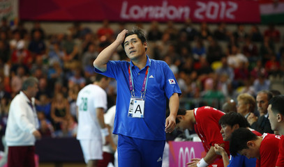 South Korea's coach Choi Suk-jai reacts on the sidelines in their men's handball Preliminaries Group B match against Hungary at the Copper Box venue during the London 2012 Olympic Games