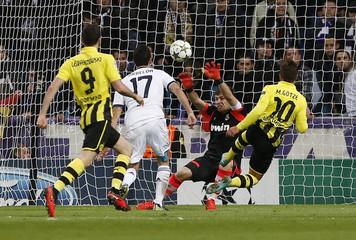 Borussia Dortmund's Mario Gotze scores a goal against Real Madrid during their Champions League soccer match at Santiago Bernabeu stadium in Madrid