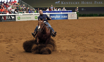Francesc Cueto of Spain riding A Real Hillbilly competes during the team reining competition at the World Equestrian Games in Lexington
