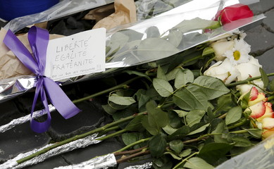 Flowers placed in sympathy with the victims of the Paris attacks are seen in front of the French embassy in Rome