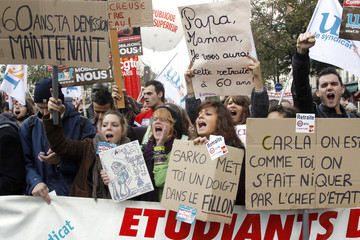 School students attend a demonstration over pension reform in Paris