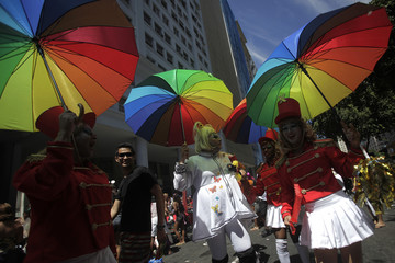 """Revellers attend the annual block party known as the """"Cordao do Bola Preta"""", one of the many carnival parties to take place in the neighbourhoods of Rio de Janeiro"""