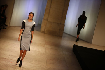 Models present a creation by fashion designer Dino Alves, as part of his Fall-Winter 2013/2014 collection, during Lisbon Fashion Week