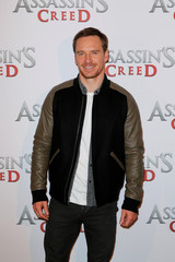 """Actor Michael Fassbender poses during a photocall to promote the film """"Assassin's Creed"""" in Paris"""