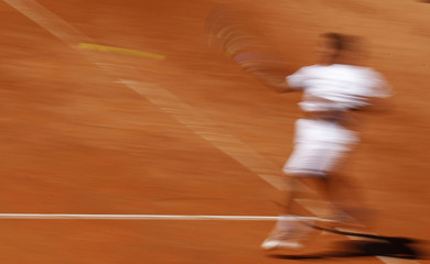 Spain's Almagro hits a return to France's Gasquet during their final match at the Swiss Open ATP tennis tournament in Gstaad
