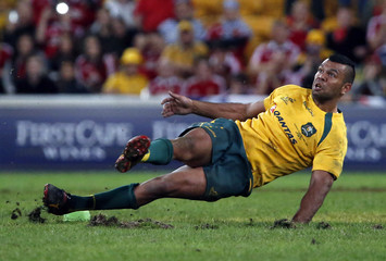 File photo of Australian rugby team player Kurtley Beale slipping as he attempts to kick a penalty goal during the rugby union test match against the British and Irish Lions at Suncorp Stadium in Brisbane