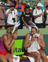 Kirilenko and teammate Petrova, of Russia wear bunny ears before trophy presentation at the Sony Ericsson Open tennis tournament in Key Biscayne
