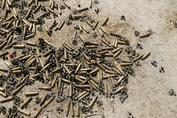 Bullet casings from clashes are seen on the ground in Falluja