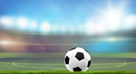 football stadium blurred background with ball and grass 3d rendering