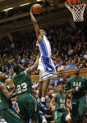Duke University's Nolan Smith goes to the basket against the University of Alabama-Birmingham's Dexter Fields, Quincy Taylor and Jamarr Sanders during the first half of their NCAA basketball game in Durham