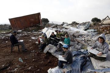 Jewish settler schoolboys take part in a lesson in Mitzpe Yitzhar