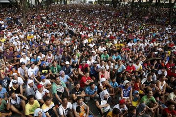 Fans of boxing icon Manny Pacquiao watch his fight with Floyd Mayweather Jr. at a public park in Marikina city