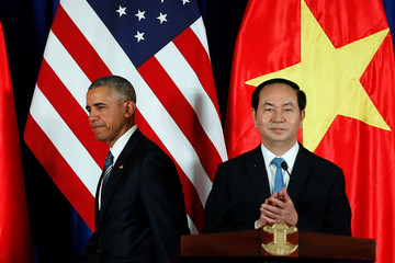 U.S. President Obama attends a news conference with Vietnam's President Tran Dai Quang at the Presidential Palace Compound in Hanoi